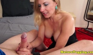 Goodlooking milf jerking a cock over her face