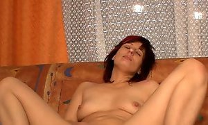 Naughty dark haired wife blows staff dick of her drunk man on sofa